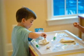 L working on coconut play dough in the art studio.