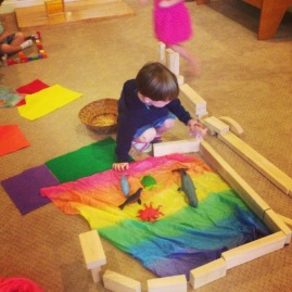 The block area has a variety of scarves and felt pieces for imaginative play.