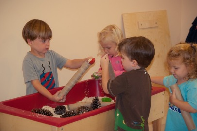 Oatmeal, tubs, cinnamon sticks, and pine cones make a wonderful fall themed sensory bin