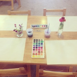 An invitation to paint with watercolors.