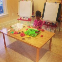M playing in our art studio.