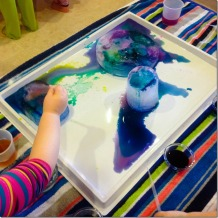 Adding salt and water colors to ice blocks