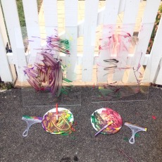 Outdoor art with plexiglass easels
