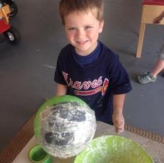 D is proud of his paper mache!
