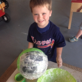 D is proud of his paper mache!