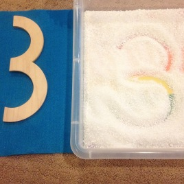 number tracing in the salt tray and building with wooden blocks